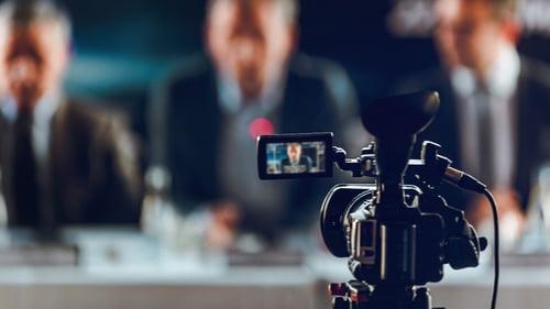 camera-at-press-conference-3LKGPXF